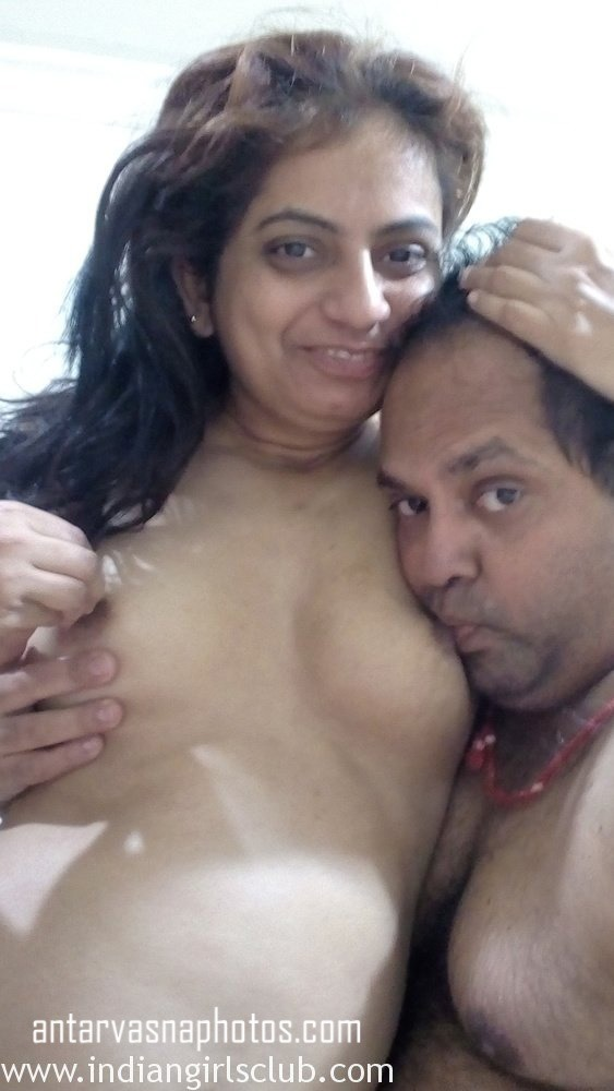 Husband sucking his wife boobs